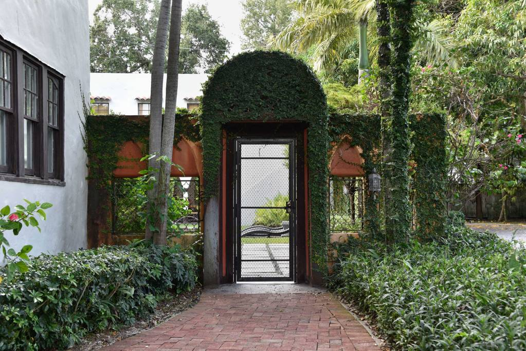Back entrance with pool and green vines of Airbnb Home